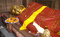 Reclining statue of Buddha at The Nirvana Temple