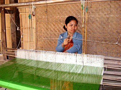 Woman in Assam weaving to contrinute to the family's  total income - Women in Indian Villages, Indian Village Society