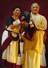 Malathi Iyengar presented a copy of her book Dance and Devotion to Bharatanatyam guru V P Dhananjayan