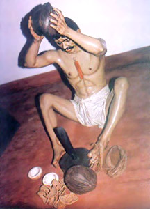 Husking and opening coconuts - Manual Labour in Cellular Jail, Andaman And Nicobar Islands