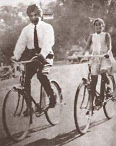 Cyling with his daughter Asha